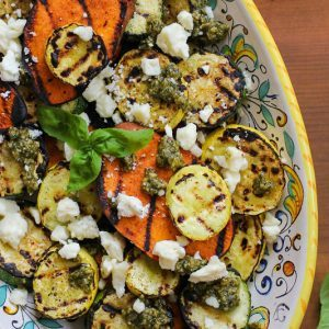 THE ROASTED ROOT GRILLED SWEET POTATOES, ZUCCHINI, AND YELLOW SQUASH WITH PESTO AND FETA