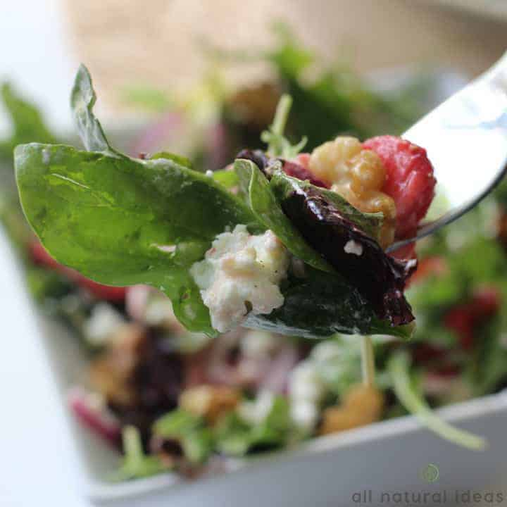 Easy spinach strawberry walnut salad on fork