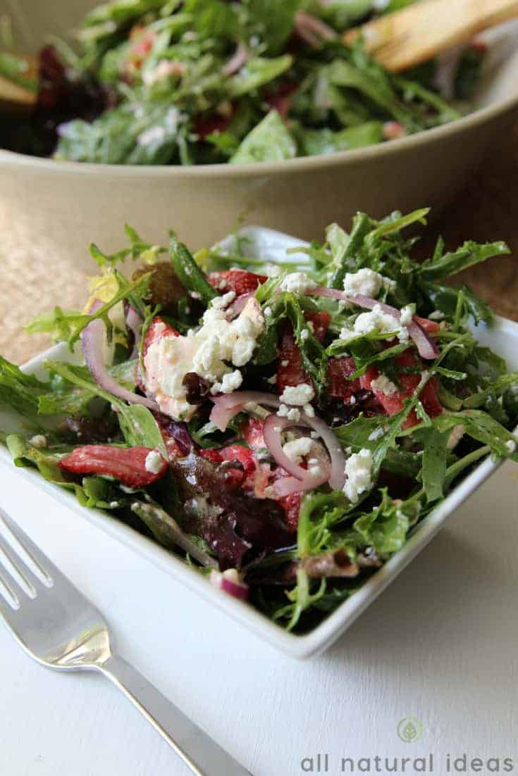 Goat cheese on an easy spinach strawberry walnut salad