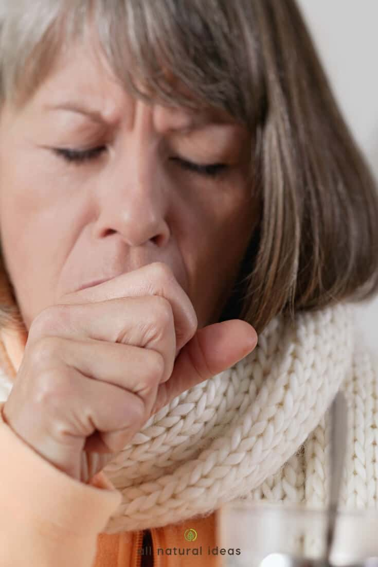 Elderly woman coughing. Essential oils for dry cough can help.
