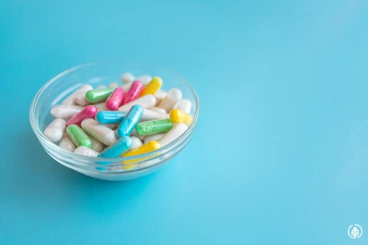 supplement capsules in a small bowl