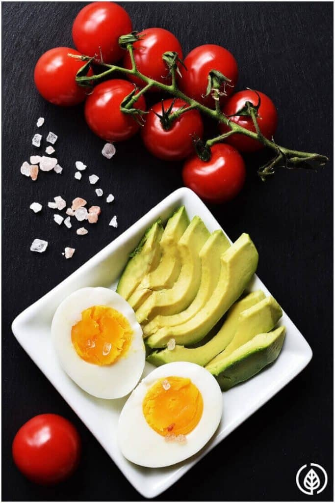 plate of avocado slices and egg with cherry tomatoes
