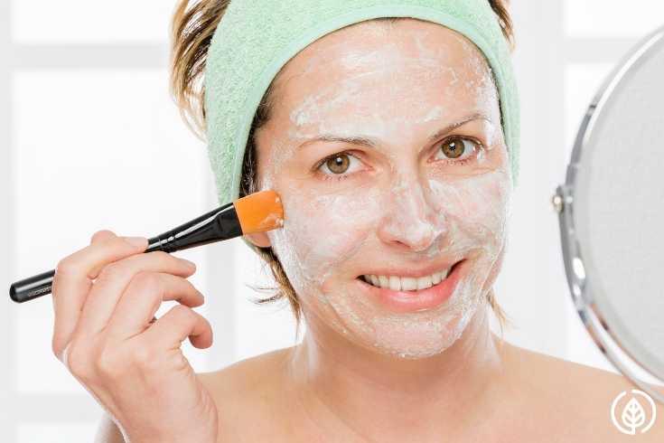 Woman Applying Mask